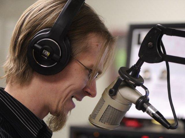Here I am in my radio studio at 87.9 KACU.